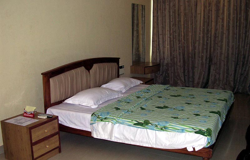 View details hotel rooms amenities reservations in goa for Normal indian bedroom designs